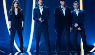 """From left, Isla Fisher, Jesse Eisenberg, Woody Harrelson and Dave Franco in a scene from """"Now You See Me."""" (AP Photo/ Summit Entertainment, Barry Wetcher)"""