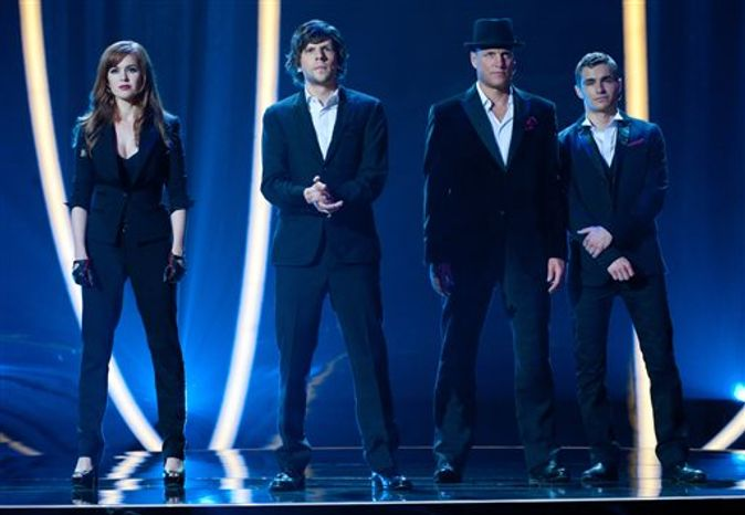 "From left, Isla Fisher, Jesse Eisenberg, Woody Harrelson and Dave Franco in a scene from ""Now You See Me."" (AP Photo/ Summit Entertainment, Barry Wetcher)"