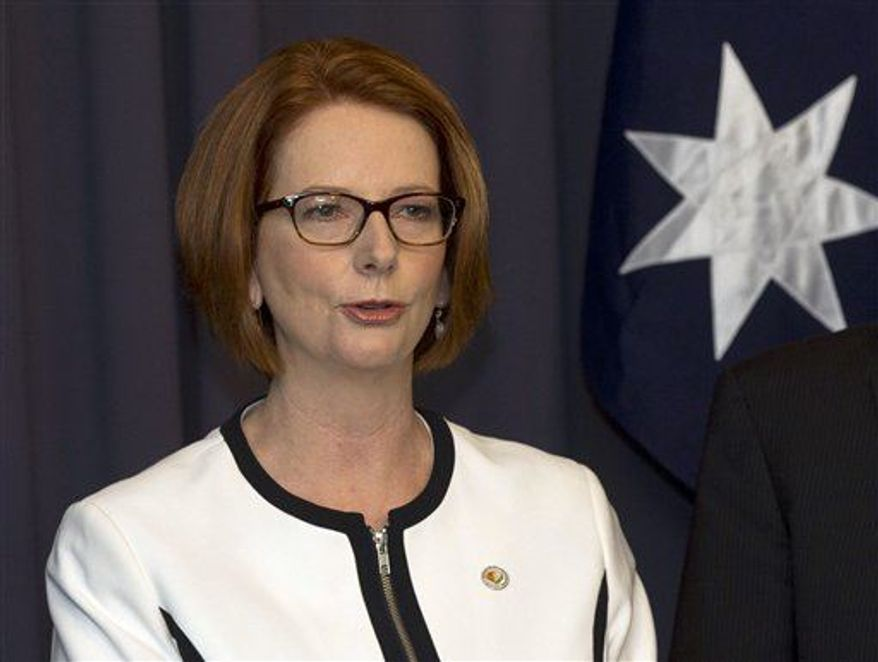 ** FILE ** Australia's Prime Minister Julia Gillard makes a statement to the media after a leadership ballot in Canberra, Australia, March 21, 2013. (Associated Press)