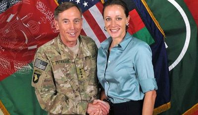 """** FILE ** U.S. Army Gen. David H. Petraeus, commander of the International Security Assistance Force and U.S. Forces-Afghanistan, shakes hands with Paula Broadwell, co-author of  """"All In: The Education of General David Petraeus,"""" in a July 13, 2011, photo from the ISAF's Flickr website. (Associated Press/International Security Assistance Force)"""