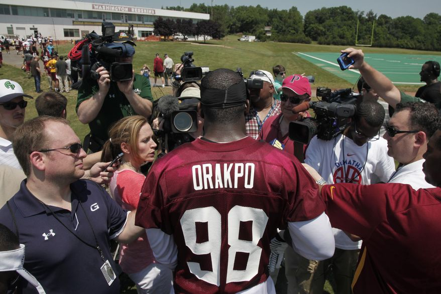 Washington Redskins linebacker Brian Orakpo (98) speaks to reporters after NFL football practice at Redskins Park in Ashburn, Va., Thursday, May 30, 2013. (AP Photo/Charles Dharapak)