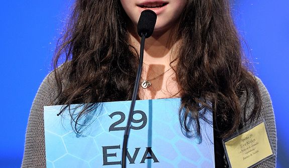 "Eva Kitlen, 14, of Niwot, Colorado  spells ""kleptocrat"" during the semi-final round of the Scripps National Spelling Bee in Oxon Hill, Md., Thursday, May 30, 2013. (AP Photo/Cliff Owen)"