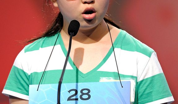 "Katharine Wang, 11, of Beijing, China incorrectly spells ""hyetomete"" during the semi-final round of the Scripps National Spelling Bee in Oxon Hill, Md., Thursday, May 30, 2013. (AP Photo/Cliff Owen)"
