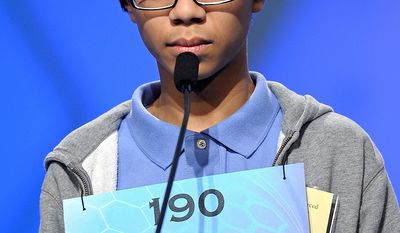 """Joseph Delamerced, 13, of Cincinnati, Oh., spells """"malleolus"""" during the semifinal round of the Scripps National Spelling Bee in Oxon Hill, Md., Thursday, May 30, 2013. (AP Photo/Cliff Owen)"""