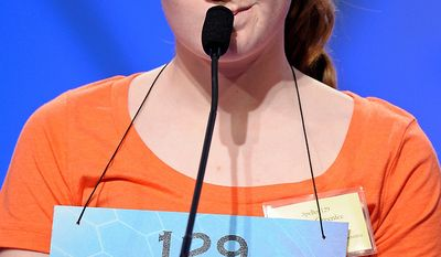 "Emma Greenlee, 14 of Aurora, Minn., spells ""joculator"" during the semifinal round of the Scripps National Spelling Bee in Oxon Hill, Md., Thursday, May 30, 2013. (AP Photo/Cliff Owen)"