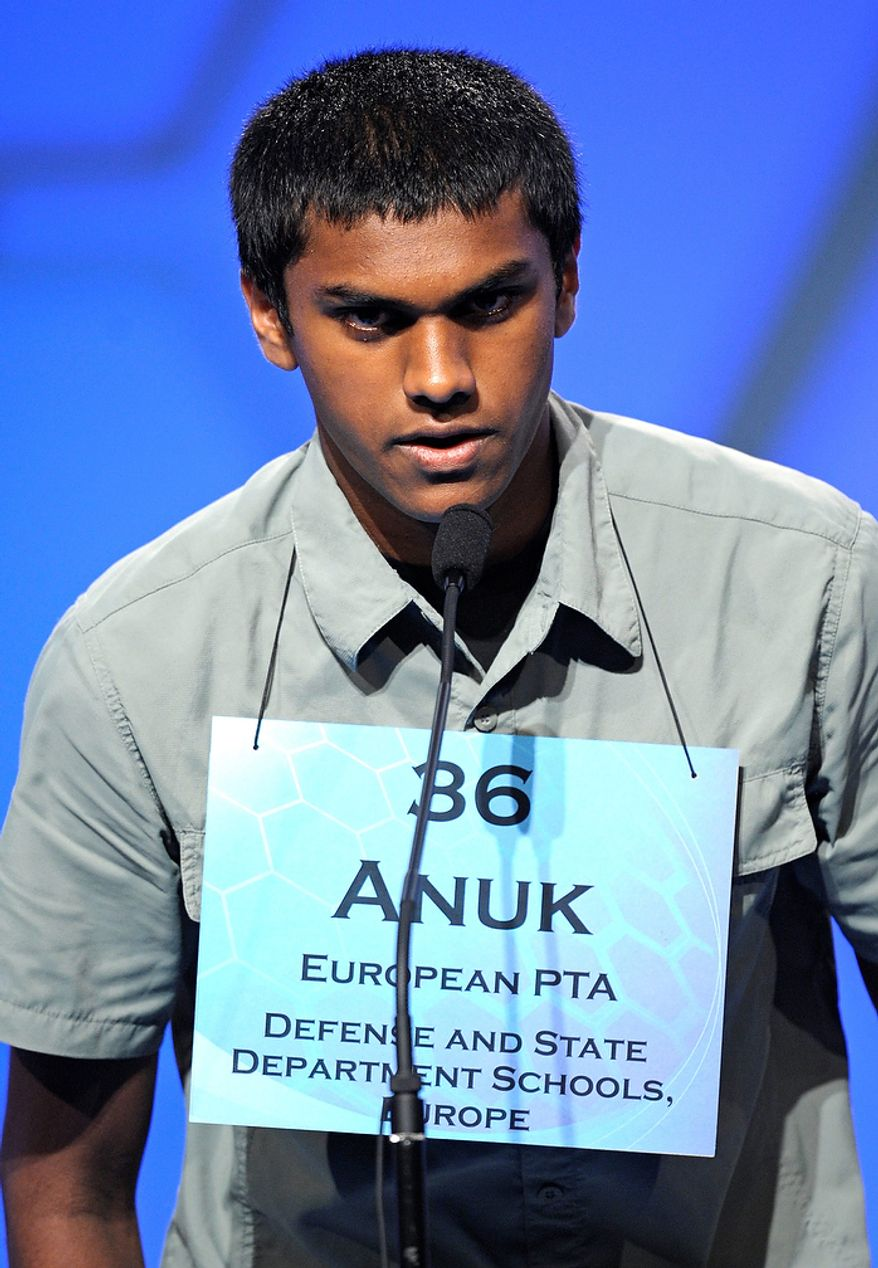 "Anuk Dayaprema, 14, of Vincenza, Italy, spells ""bavardage"" during the semifinal round of the Scripps National Spelling Bee in Oxon Hill, Md., Thursday, May 30, 2013. (AP Photo/Cliff Owen)"