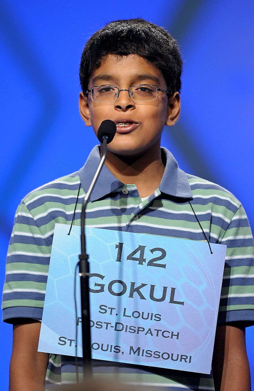 "Gokul Venkatachalam, 12, of Chesterfield, Mo.,  spells ""smellfungus"" during the semifinal round of the Scripps National Spelling Bee in Oxon Hill, Md., Thursday, May 30, 2013. (AP Photo/Cliff Owen)"
