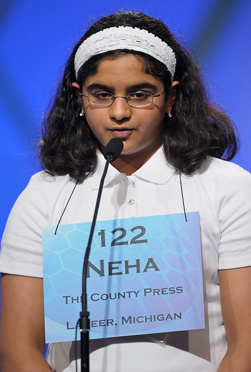 "Neha Seshadri, 12, of Imlay City, Mich., spells ""physiognomy"" during the semifinal round of the Scripps National Spelling Bee in Oxon Hill, Md., Thursday, May 30, 2013. (AP Photo/Cliff Owen)"