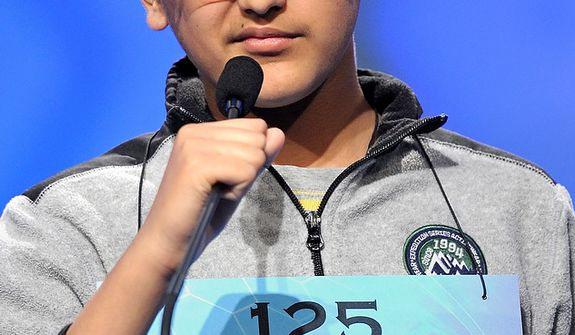 "Kuvam Shahane, 13, of Rochester Hills, Mich., spells ""griseous"" during the semifinal round of the Scripps National Spelling Bee in Oxon Hill, Md., Thursday, May 30, 2013. (AP Photo/Cliff Owen)"
