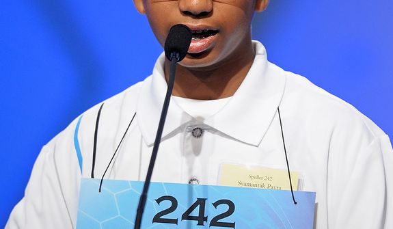 "Syamantak Payra, 12, of Friendswood, Texas, spells ""hepatectomy"" during the semifinal round of the Scripps National Spelling Bee in Oxon Hill, Md., Thursday, May 30, 2013. (AP Photo/Cliff Owen)"