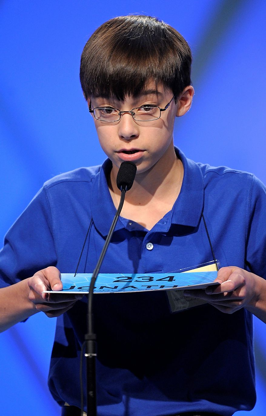 """Jonathan Caldwell, 13, of Hendersonville, Tenn., spells """"persiflage"""" during the semifinal round of the Scripps National Spelling Bee in Oxon Hill, Md., Thursday, May 30, 2013. (AP Photo/Cliff Owen)"""