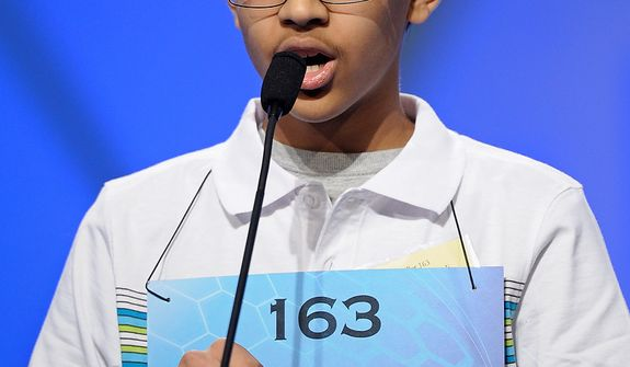 "Arvind Mahankali, 13, of Bayside Hills, N.Y., spells ""intravasation"" during the semifinal round of the Scripps National Spelling Bee in Oxon Hill, Md., Thursday, May 30, 2013. (AP Photo/Cliff Owen)"