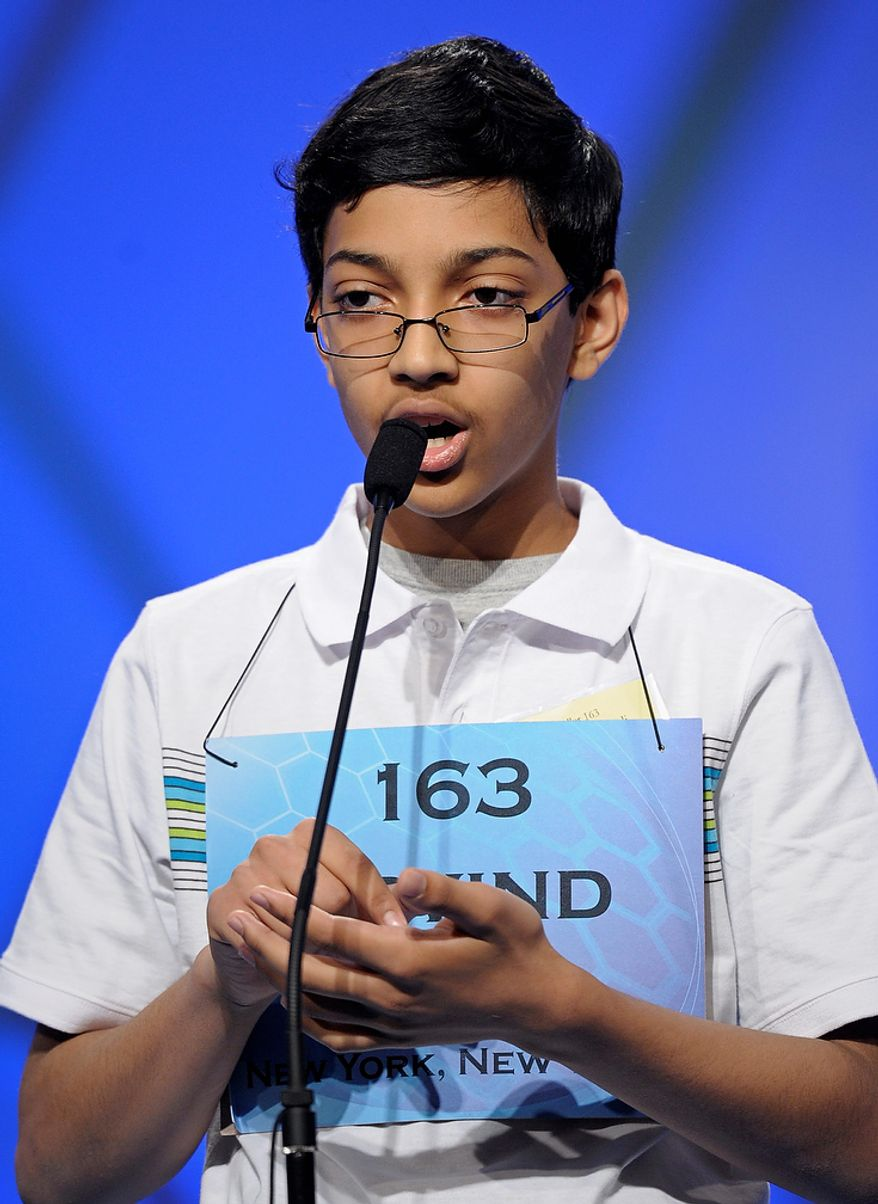 """Arvind Mahankali, 13, of Bayside Hills, N.Y., spells """"intravasation"""" during the semifinal round of the Scripps National Spelling Bee in Oxon Hill, Md., Thursday, May 30, 2013. (AP Photo/Cliff Owen)"""