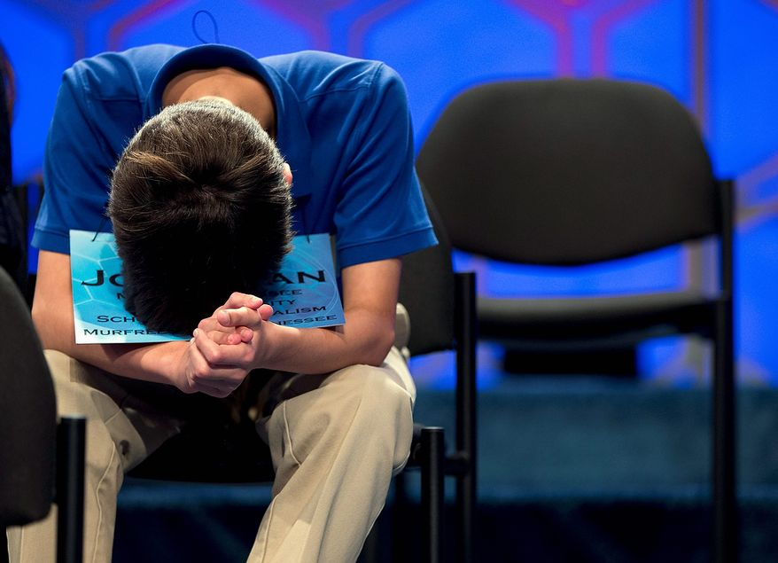 Jonathan Caldwell, 13, of Hendersonville, Tenn., waits for his turn during the semifinal round of the National Spelling Bee on Thursday, May 30, 2013, in Oxon Hill, Md. (AP Photo/Evan Vucci)