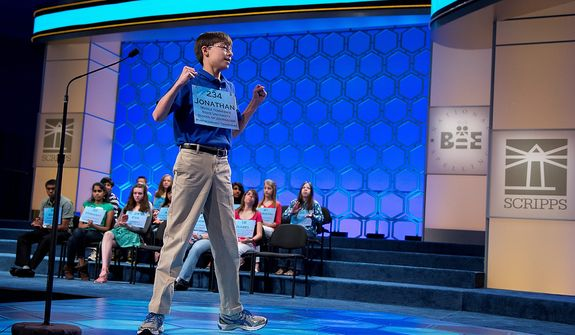 "Jonathan Caldwell, 13, of Hendersonville, Tenn., reacts after spelling the word ""persiflage"" correctly during the semifinal round of the National Spelling Bee, Thursday, May 30, 2013, in Oxon Hill, Md. (AP Photo/Evan Vucci)"