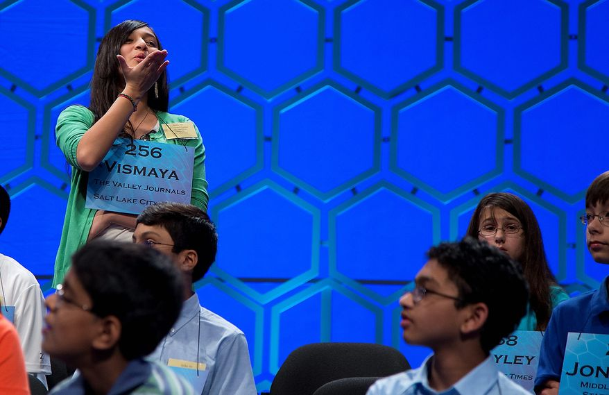 Vismaya Kharkar, 14, of Bountiful, Utah blows a kiss to her family during a break in the semifinal round of the National Spelling Bee, Thursday, May 30, 2013, in Oxon Hill, Md. (AP Photo/Evan Vucci)