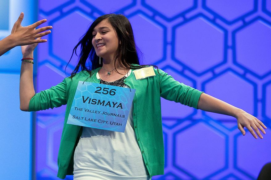 Vismaya Kharkar, 14, of Bountiful, Utah, celebrates after learning that she made the finals of the National Spelling Bee on Thursday, May 30, 2013, in Oxon Hill, Md. (AP Photo/Evan Vucci)