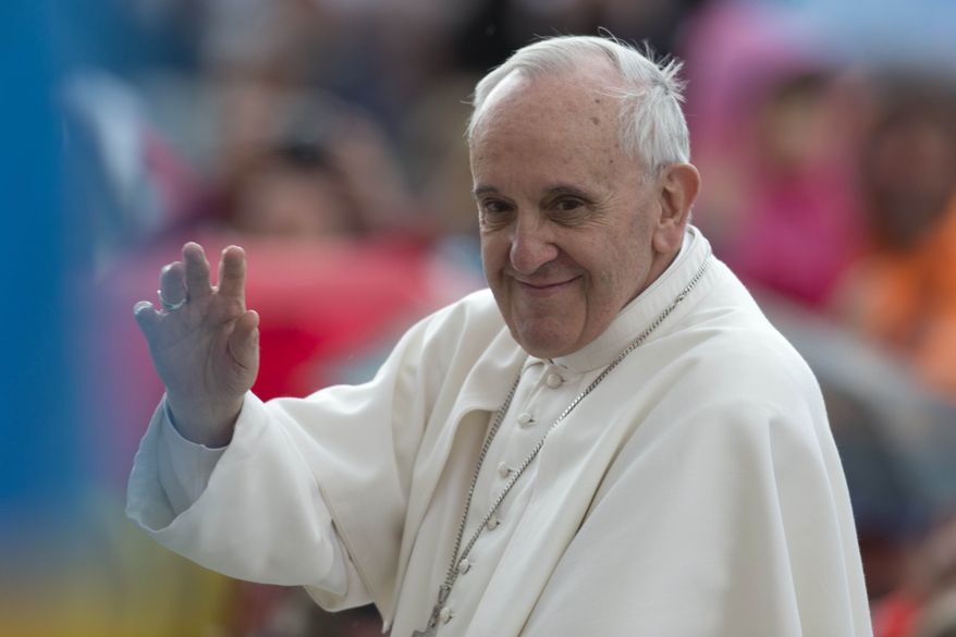 Pope Francis waves in St. Peter's Square at the Vatican as he leaves at the end of his weekly general audience on Wednesday, May 29, 2013. (AP Photo/Andrew Medichini)