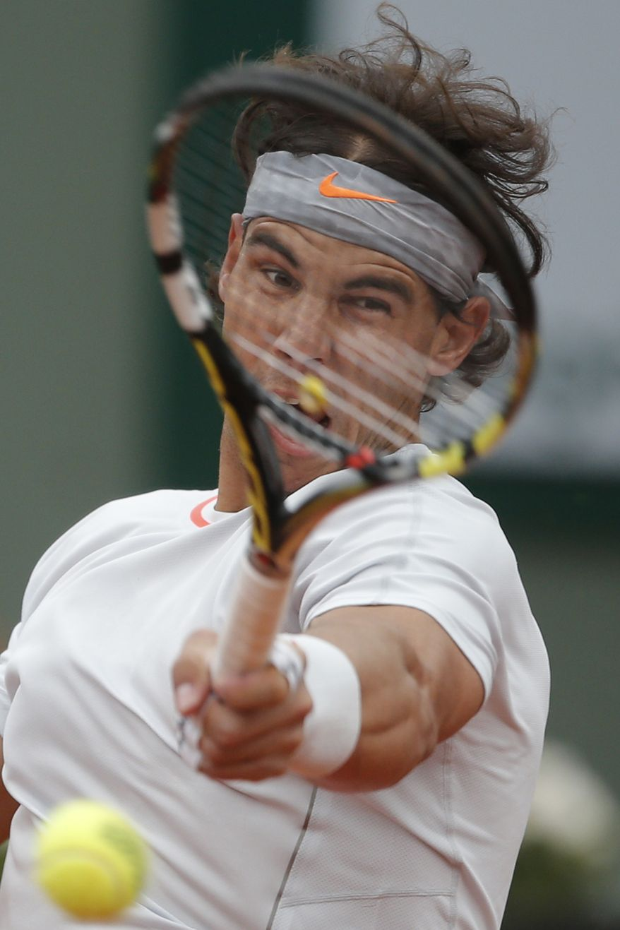 Spain's Rafael Nadal returns against Slovakia's Martin Klizan in their second round match at the French Open tennis tournament, at Roland Garros stadium in Paris, Friday, May 31, 2013. (AP Photo/Michel Spingler)