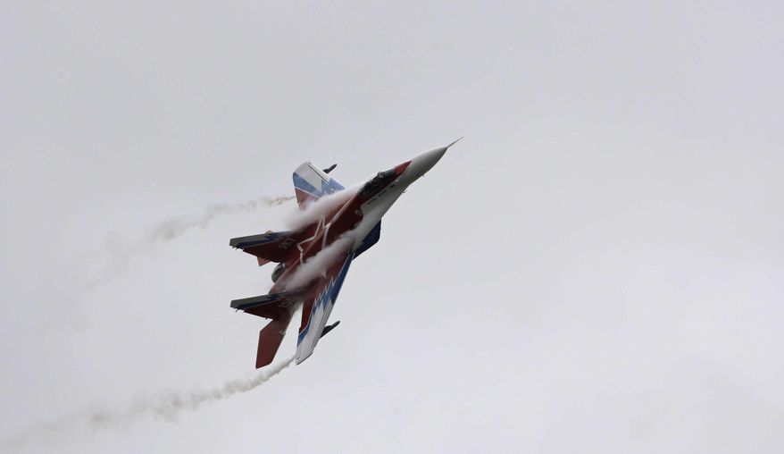 A Russian-made MiG-29 jet performs stunts outside Moscow, Aug. 21, 2009. (Associated Press) ** FILE **
