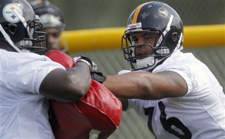** FILE ** Pittsburgh Steelers tackle Mike Adams (76) goes through blocking drills during practice at NFL football training camp in Latrobe, Pa., Friday, July 27, 2012. (AP Photo/Keith Srakocic)