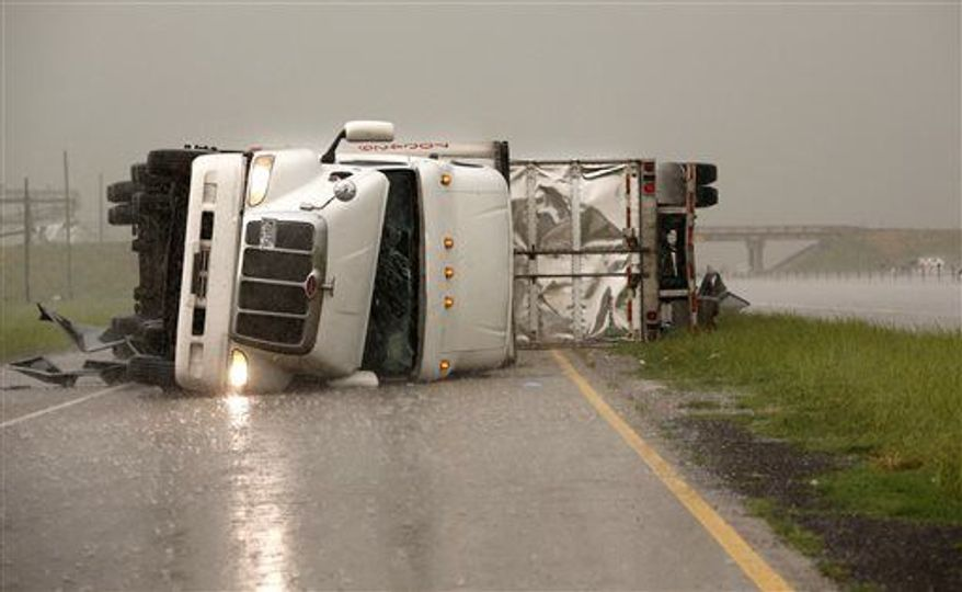 Overturned trucks block a frontage road off I-40 just east of 81 in El Reno, Okla., after a tornado moved through the area on Friday, May 31, 2013. (Associated Press)