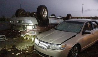 Cars that were damaged by a tornado in parking lot at Canadian Valley Technical Center on State Highway 66, west of Banner Road, Friday May 31, 2013 in El Reno, Okla. (Associated Press)