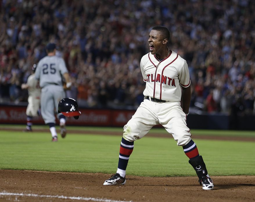 B.J. Upton celebrates his game-winning hit as the Nationals walk off the field following a 2-1 loss. (Associated Press photo)