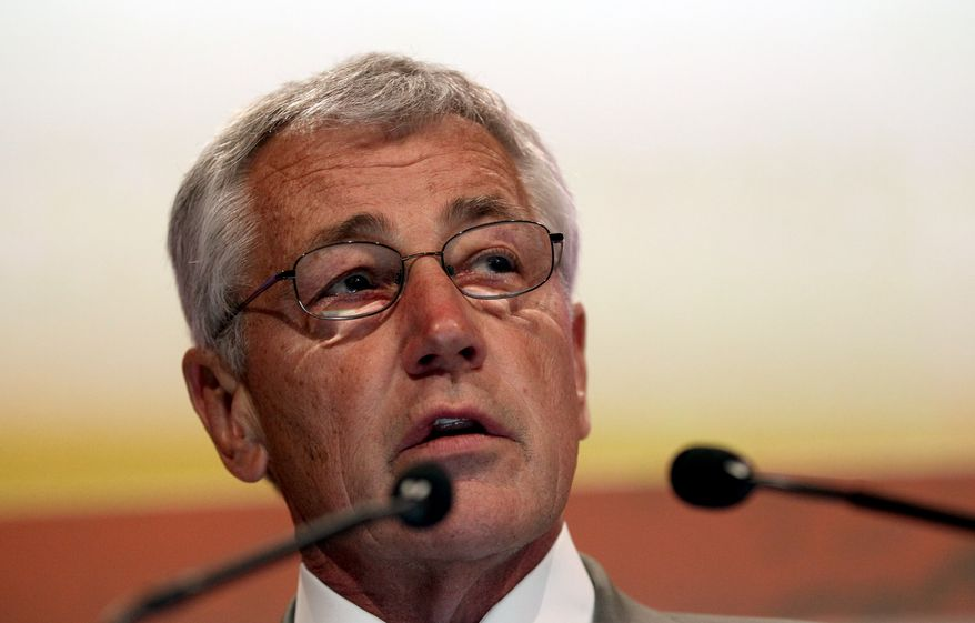 """U.S. Defense Secretary Chuck Hagel delivers his keynote address on """"The U.S. Approach to Regional Security"""" at the International Institute for Strategic Studies Shangri-la Dialogue, or IISS Asia Security Summit, on Saturday, June 1, 2013, in Singapore. (AP Photo/Wong Maye-E)"""