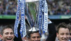 FILE - A Saturday, May 7, 2005 photo from files showing Chelsea FC manager Jose Mourinho celebrating the FA Premiership trophy with Frank Lampard, left, and John Terry, after winning the English Premiership League at Stamford Bridge in London. Jose Mourinho is officially returning to Chelsea as the London club's new manager, six years after his acrimonious departure. Chelsea confirmed Monday, June 3, 2013 that the 50-year-old Mourinho was hired on a four-year contract after completing a three-year stint at Real Madrid, where his final season ended without a trophy. Madrid released the Portuguese coach from his contract a year early, so Chelsea owner Roman Abramovich will not have to pay compensation to be re-united with the manager he fell out with in 2007. (AP Photo/Alastair Grant, File)