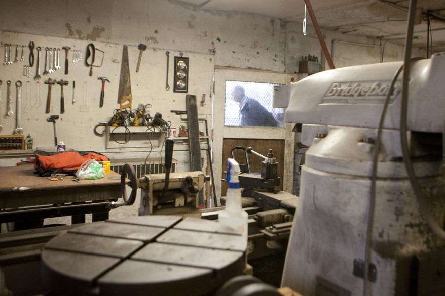 Mike Kastner leaves the unfinished lower half of a building acquired by his son Daniel's company, 1977 Mopeds, which sells moped parts online, on May 14, 2013, in Kalamazoo, Mich. (AP Photo/Kalamazoo Gazette, James Buck)