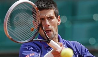 Serbia's Novak Djokovic returns against Germany's Philipp Kohlschreiber in their fourth round match at the French Open tennis tournament, at Roland Garros stadium in Paris, Monday June 3, 2013. (AP Photo/Michel Spingler)