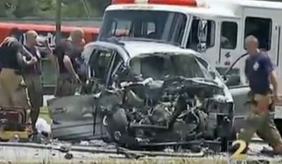 """In this image taken from video, emergency personnel work the scene of a car crash Friday, May 31, 2013, in Jonesboro, Ga. Former NBA All-Star guard Daron """"Mookie"""" Blaylock's SUV crossed the center line and crashed head-on into a van in suburban Atlanta, police said.  (AP Photo/WSB-TV)"""