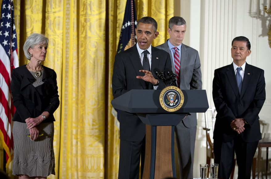 President Obama, accompanied by (from left) Health and Human Services Secretary Kathleen Sebelius, Education Secretary Arne Duncan and Veterans Affairs Secretary Eric Shinseki. speaks during the White House mental health conference on June 3, 2013, in the East Room of the White House. The conference was organized as part of President Obama's response to last year's shooting massacre at a Connecticut elementary school. (Associated Press)