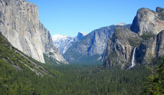 ** FILE ** This April 2013 image shows Yosemite Valley as seen from Tunnel View with three of Yosemite National Park's best-known natural attractions: The El Capitan summit on the left, the granite peak known as Half Dome in the distant center, and Bridalveil Fall on the right. (AP Photo/Kathy Matheson)