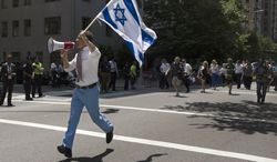 New York City mayoral candidate and former U.S. Rep. Anthony Weiner waves an Israeli flag as he marches up New York's Fifth Avenue in the Israel Day Parade Sunday, June 2, 2013. (AP Photo/Cassandra Giraldo)