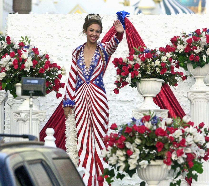 """Attorney Erika Harold, who was named Miss America 2003, on Tuesday announced her intent to run for U.S. Congress in the 13th Congressional District of Illinois. """"I have a pretty thick skin at this point in my life,"""" she said. (Associated Press)"""