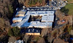 Sandy Hook Elementary School in Newtown, Conn., will be torn down and a new school built on the land after 26 people were killed there in December. At Virginia Tech, however, Norris Hall still stands and is used for research and classes. Specialists say it's up to each community to decide what's best. (Associated Press)