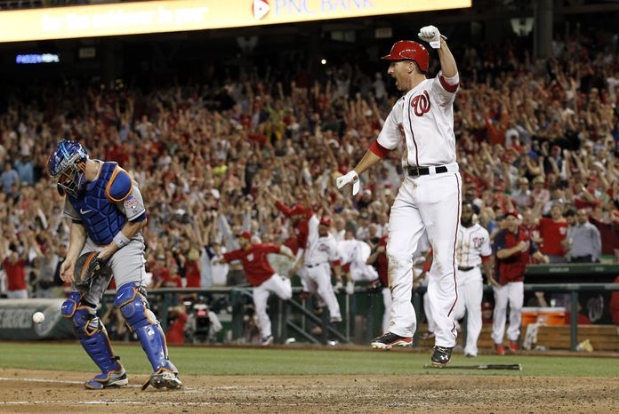 Adam LaRoche and the Nationals celebrate their first walk-off win of the season, beating the Mets on Tuesday 3-2. (Associated Press photo)