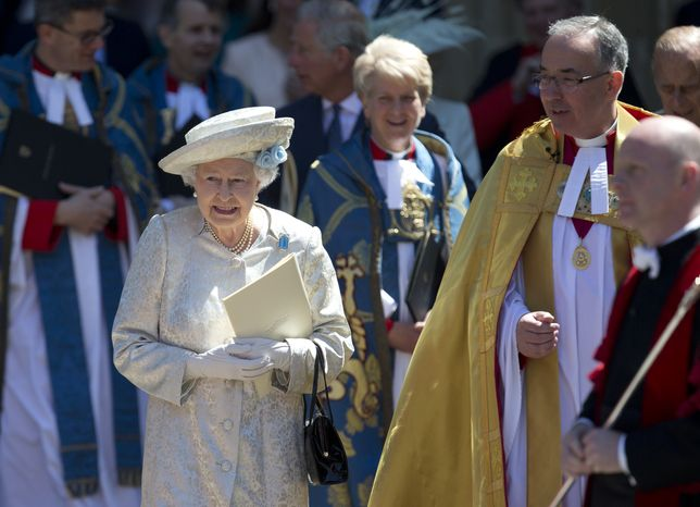 Britain's Queen Elizabeth II, escorted by the Very Rev. John Hall, dean of Westminster Abbey, leaves the church in London on Tuesday, June 4, 2013, after a service to celebrate the 60th anniversary of her coronation. (AP Photo/Alastair Grant)