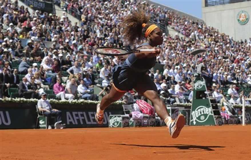 Serena Williams, of the U.S, reaches for a ball as she plays Russia's Svetlana Kuznetsova during their quarterfinal match of the French Open tennis tournament at the Roland Garros stadium Tuesday, June 4, 2013 in Paris. (AP Photo/Michel Euler)