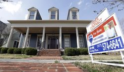 """An """"Under Contract"""" sign is posted outside a home in Carmel, Ind., an Indianapolis suburb, on Tuesday, April 9, 2013. (AP Photo/Michael Conroy)"""