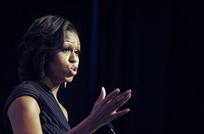** FILE ** First lady Michelle Obama addresses the Congressional Black Caucus Foundation's 42nd annual Phoenix Awards dinner in Washington on Saturday, Sept. 22, 2012. (