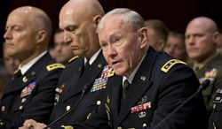 ** FILE ** Joint Chiefs Chairman Gen. Martin Dempsey (right) testifies June 4, 2013, on Capitol Hill before the Senate Armed Services Committee hearing to investigate the growing epidemic of sexual assaults within the military. From right are Dempsey, Army Chief of Staff Gen. Ray Odierno and Judge Advocate General of the Army Lt. Gen. Dana K. Chipman. (Associated Press)