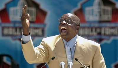 In this Aug. 3, 2002 file photo, Hall of Fame defensive end Deacon Jones presents the late coach George Allen for enshrinement into the Pro Football Hall of Fame in Canton, Ohio. / Associated Press