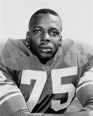 "FILE - This 1963 file photo shows David Deacon Jones. Jones, a Hall of Fame American football defensive end credited with terming the word sack for how he knocked down quarterbacks, has died. He was 74. The Washington Redskins said that Jones died Monday night June 3, 2013 of natural causes at his home in Southern California. Redskins general manager Bruce Allen, whose father, George, coached Jones with the Los Angeles Rams, calls Jones ""one of the greatest players in NFL history. (AP Photo/File)"