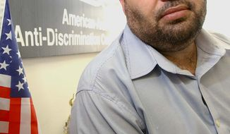 ** FILE ** Imad Hamad, director of the Michigan office of the American-Arab Anti-Discrimination Committee, sits in his office in Dearborn, Mich., in 2002. (AP Photo/Jerry S. Mendoza)