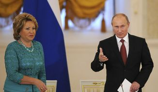 Valentina Matviyenko (left), the speaker of Russia's Senate, and Russian President Vladimir Putin attend a State Council meeting in the Kremlin in Moscow on Friday, May 31, 2013. (AP Photo/Yuri Kadobnov, Pool)