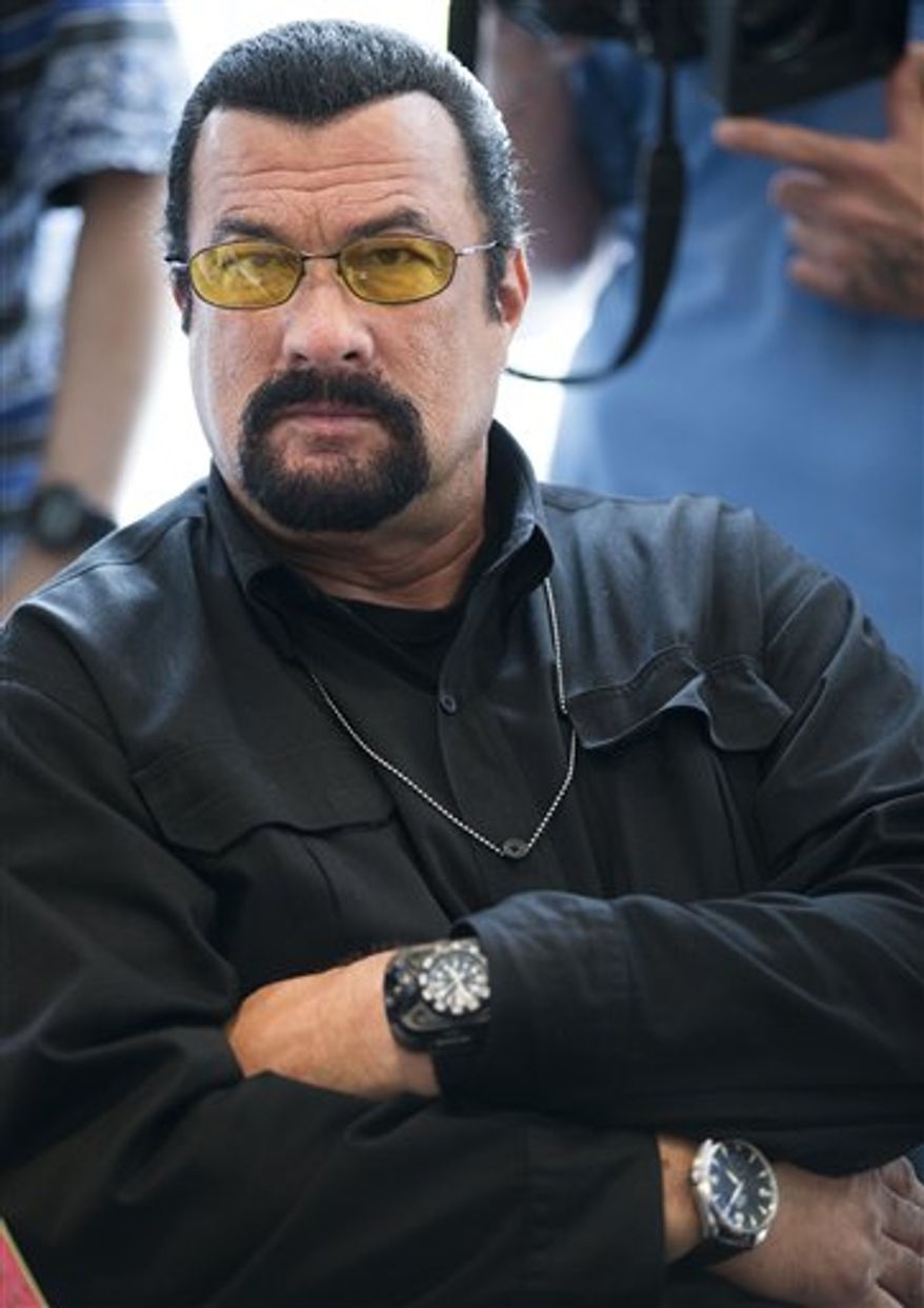 Russia hopes to recruit Steven Seagal as the face of an international marketing campaign to promote its weapons exports. The action movie star is shown here waiting for a news conference with a U.S. Congressional delegation at the American Embassy in Moscow on June 2, 2013. (AP Photo/Alexander Zemlianichenko)