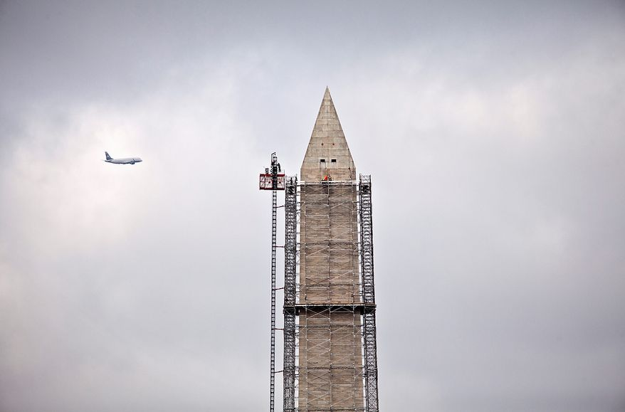 Scaffolding rises to the top of the Washington Monument in Washington, Thursday, May 2, 2013, so craftsmen can make repairs to the 555-foot marble obelisk that was damaged in the August 2011 earthquake. (AP Photo/J. Scott Applewhite)